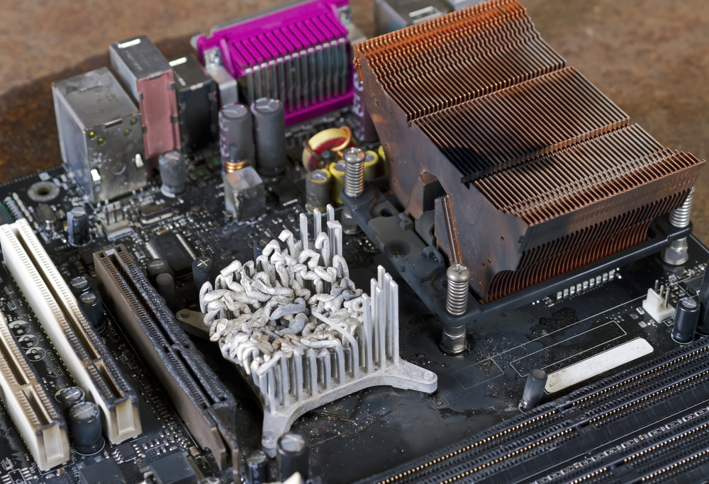 Damaged computer components and motherboard as the result of a poor heat sink design